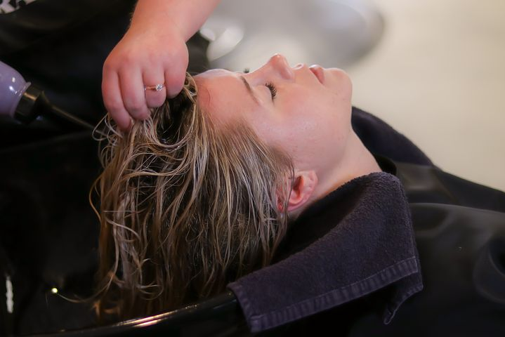 woman getting her hair washed in a salon